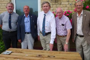 Inspecting the newly dedicated bench seat at the club, left to right, Councillor John Copsey, Club member Martin Burnhill, Sir Greg Knight MP, Councillor Chad Chadwick and Councillor Chris Matthews.