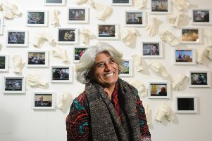 Artist Shanthamani Muddaiah with her exhibition in Settle