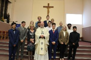 Bishop Marcus with Head Teacher Ann Bradbury along with students from St John's