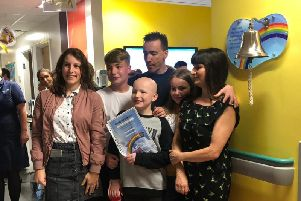 Joel with dad David, brother and sister Jake and Jasmine and family friends Andrea Rowson and daughter Lauren at Manchester Children's Hospital in September