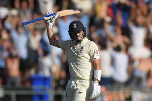 England batsman Ollie Pope reaches his 50 during Day One of the Second Test between England and South Africa in Cape Town, South Africa. (Picture: Stu Forster/Getty Images)