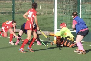 Garstang Hockey Club's Steph Roe comes close to scoring with Alice Noble in close support