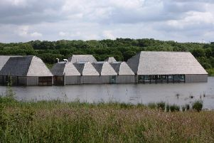 Brockholes Visitor Village at Samlesbury where the buildings are designed to rise as  water levels rise.