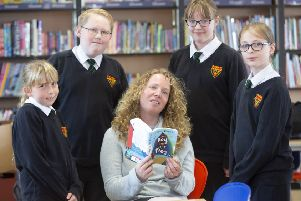 Chloe Daykin with young readers from Cramlington Learning Village.