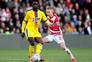 Ready for derby: Doncaster's Ali Crawford, right, challenging Crystal Palace's Jeffrey Schlupp in the FA Cup encounter.
