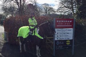 Mounted police are part of a high-visibility patrol around Runshaw College after  a 17-year-old pupil was stabbed outside the campus yesterday (March 4).