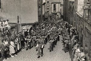 DLI soldiers march up Owengate. Ref no: (D/DLI 2/1/280 (607)) Photo; Durham County Record Office.