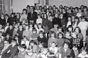 Preston headmaster Frederick Green is pictured here with staff and pupils at Brookfield Primary School. They were gathered together for surprise celebrations to mark his selfless work at the school since it opened in 1958