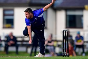 James Byrne claimed 3-31 as Hanging Heaton defeated Yorkshire Vikings. Pics: Paul Butterfield
