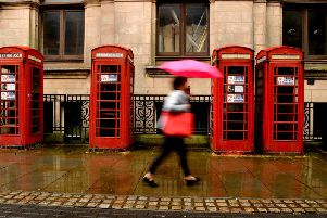 The row of red phone boxes outside the former Head Post Office in Market Street have seen better days