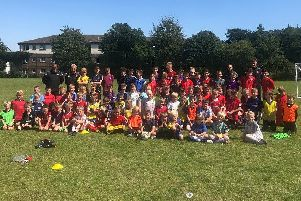 The Shrimps' Academy coaches with youngsters on the Isle of Man