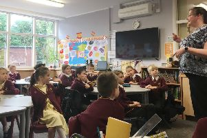 Children take part in a lesson baout deafness to mark Deaf Awareness Week.