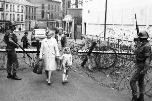 People in the Bogside area of Londonderry after a night of rioting in August 1969