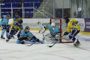 UNDER PRESSURE: Leeds Chiefs' Steven Moore, far right, tries to get a shot in on Sheffield Steeldogs' netminder Dmitri Zimozdra. Picture: Cerys Molloy