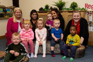 Some of the team  and children at Queensbury Private Day Nursery.