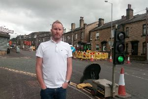 Darren Leach, owner of Cuttin Edges Carpets by the Ovenden roadworks.