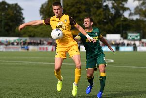 SUTTON, GREATER LONDON - SEPTEMBER 07: Aaron Jarvis of Sutton United controls the ball under pressure from Michael Doyle of Notts County during the Vanarama National League match between Sutton United and Notts County at Knights Community Stadium on September 07, 2019 in Sutton, Greater London. (Photo by Harriet Lander/Getty Images)