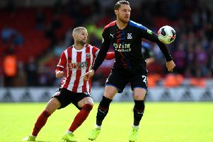 Sheffield United's Oliver Norwood with Crystal Palace's Connor Wickham