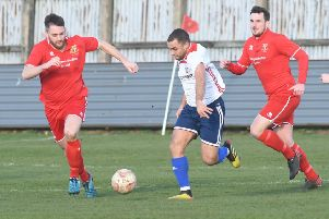 Bridlington Town's Chris Jenkinson and Jack Griffin closing in on Yorkshire Amateur's Ashley Flynn