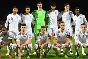 Nick Pope likes up with the England team before kick-off in Pristina