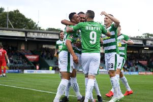 YEOVIL, ENGLAND - AUGUST 06: Courtney Duffus of Yeovil Town(L) celebrates after scoring his sides first goal during the Vanarama National League match between Yeovil Town and Eastleigh FC at Huish Park on August 06, 2019 in Yeovil, England. (Photo by Harry Trump/Getty Images)