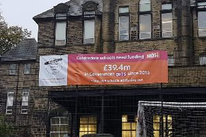 Calderdale Against School Cuts are displaying anti-cuts to education banners across schools in the area
