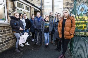 Caroline Dean, right, and other parents outside New Road Children's Centre Nursery, Sowerby Bridge. Photo by Jim Fitton.