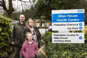 Dale Group Practice closing. Patients Robert Hills, Michelle Hills and Amelia Bedford, seven, outside Allan House Health Centre, Sowerby Bridge.