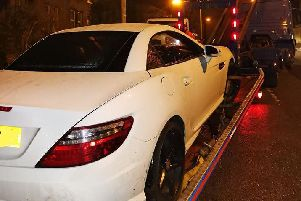 The stolen car from Leeds being recovered by police