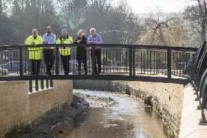 New pedestrian bridge and flood defences at Mytholmroyd. From the left, VBA senior project manager Chris Blenkam, Russell Edwards from People for Places, Environment Agency project manager Ian Waller, Mark Tupman, Environment Agency senior flood advisor, and concillor Barry Collins, cabinet member for regeneration and economic strategy.