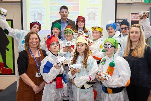 Nook Lane Junior School 'take on the Dragons- in entrepreneurial competition. with managing director of UK Steel Enterprise, Simon Hamilton at the back