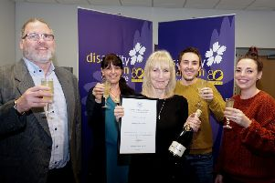 Disability Action Yorkshire staff members celebrate the award.