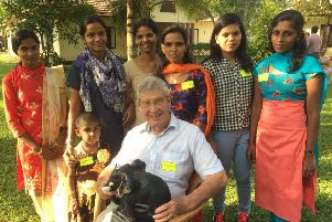 John Veitch, the Calderdale businessman who founded Hope Community Village, with some of the children it has supported.
