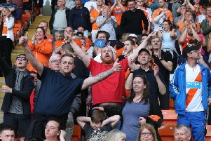 Supporters enjoy the big-match atmosphere at Bloomfield Road