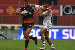Mike McMeeken tries to get free in Castleford Tigers' game against Catalans Dragons. Picture: Matthew Merrick