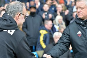 Chris Wilder (right) has pipped Leeds boss Marcelo Bielsa (left) to automatic promotion to the Premier League
