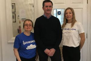 Partners: Mark Bannister,  MD of Eclipse Energy,  centre, with Rachel Dilley and Louise Reed from Focus4Hope.