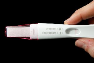 A home pregnancy test, and its instructions.