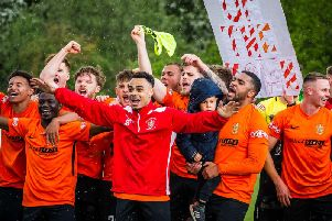 Brighouse Town celebrate victory in the play-off final. PIC: James Heaton.