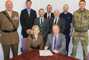 CHoICE Managing Director Ian Makinson signing the Armed Forces Covenant alongside Major Terry McDermott-Moses, with, left to right, Warrant Officer 1 Den Mustard, David Eccels, Gary McLafferty, Mark Stouph, Brian Hughes-Mundy, Mark Hope and Nathan Gibson.