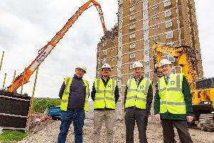 Scott Boyd, Delivery Surveyor at Together Housing Group; Andy Fisk, Director of Rhodars Demolition Division; Dave Procter, Chair of Together Housing Group; and Mark Thompson, Director of Regeneration and Strategy at Calderdale Council.