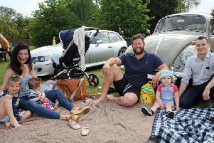 The Sheehans, from Sturton, and the Vaccaris, from Leverton, picnic alongside a '63 VW Beetle at the event.