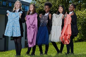 Support: Pupils Jaymee-Leigh, Molly, Angell, Alyssa and Danielle with some of the donated dresses.