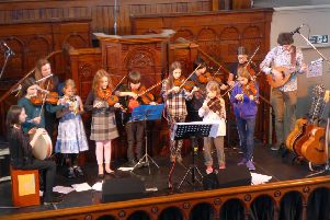 Roots Festival: Calder Youth Folk group members perform in Hope Baptist Church during the recent Hedben Bridge festival.