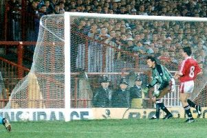 Tony Gregory's looping header drops in. Halifax v Manchester United, League Cup Second Round, 1990. Photo: Johnny Meynell.