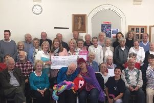 The Singing for the Brain group produced a CD which has raised �2,000.