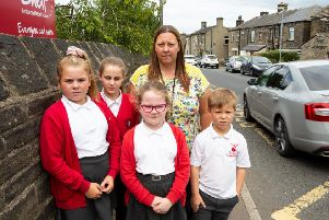 Head Teacher Jill Elam with children at Shelf J&I School, concerned about traffic speeding and parking around the school