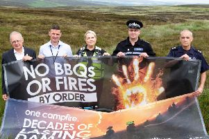 Coun Tim Swift, Ollie Crosland, SCSW Natasha Lymm, valleys inspector Ben Doughty and Tomorden Fire watch commander Geoff Shaw. WYFRS launching moorland fire campaign, Byrons Edge, Turvin Road