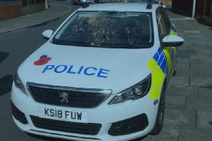 A 29-year-old man has been charged with criminal damage after climbing onto a police car in Blackpool and causing damage to the roof and window