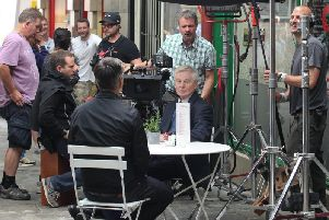 Derek Jacobi filming for series three outside Upstairs Downstairs in Halifax town centre